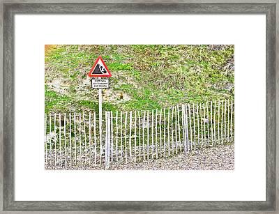 Cliff Warning Framed Print by Tom Gowanlock