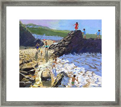 Climbing On The Rocks, St Ives Framed Print by Andrew Macara