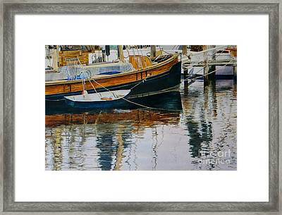 Clinging Dingy Framed Print by Karol Wyckoff