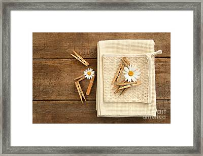 Close-pins And Dish Towels On Old Table  Framed Print by Sandra Cunningham