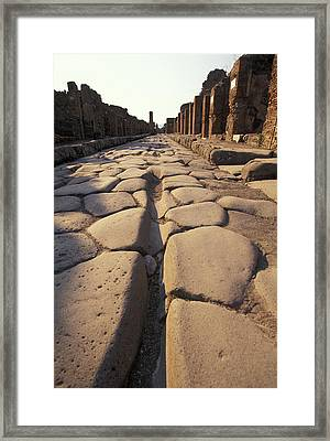 Close Up Of A Chariot Rut In Ancient Framed Print by Richard Nowitz