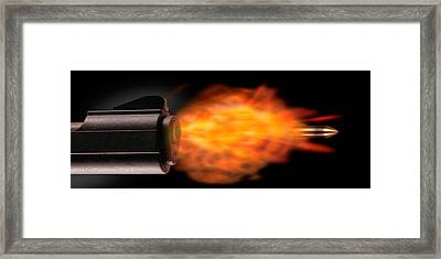 Close-up Of A Gun Firing A Bullet Framed Print by Panoramic Images