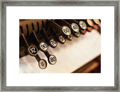 Close-up Of Antique Cash Register Keys Framed Print by Bradley Hebdon