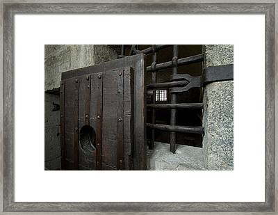 Close View Of Heavy Door To A Cell Framed Print by Todd Gipstein