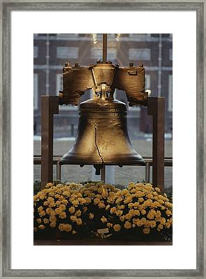 Close View Of The Liberty Bell Framed Print by Kenneth Garrett