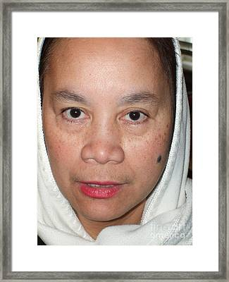Closeup Of A Filipina Woman With A Mole On Her Cheek And Wearing A Scarf Framed Print by Jim Fitzpatrick