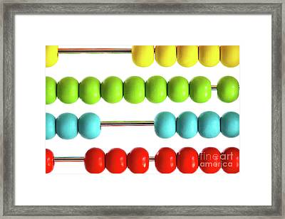 Closeup Of Bright  Abacus Beads On White Framed Print by Sandra Cunningham