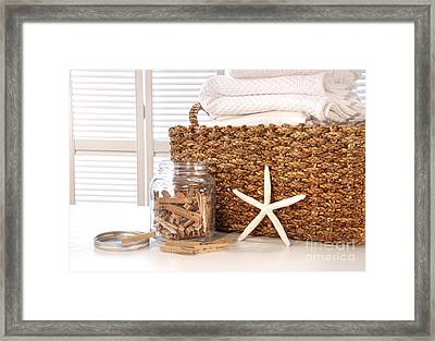 Closeup Of Laundry Basket With Fine Linens  Framed Print by Sandra Cunningham