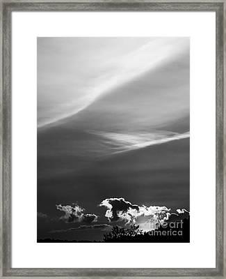 Clouds On The Horizon Framed Print by James Aiken