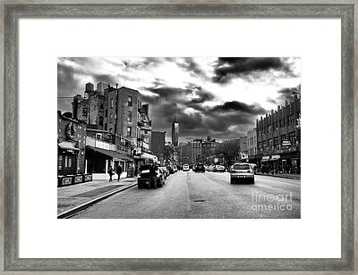 Clouds Over 7th Avenue Framed Print by John Rizzuto