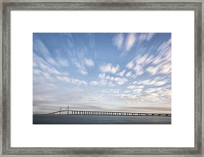 Clouds Over The Skyway Framed Print by Jon Glaser