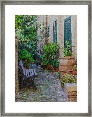 Cobblestone Courtyard Of Tuscany Framed Print by David Letts