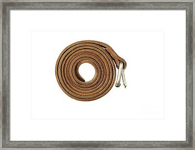 Coiled Leather Belt On A White Background Framed Print by Michal Boubin