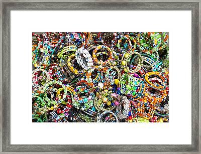 Colorful Bracelets Framed Print by Tom Gowanlock