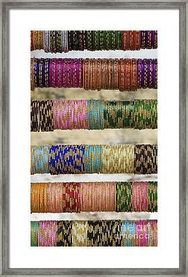 Coloured Glass Indian Bangles Framed Print by Tim Gainey