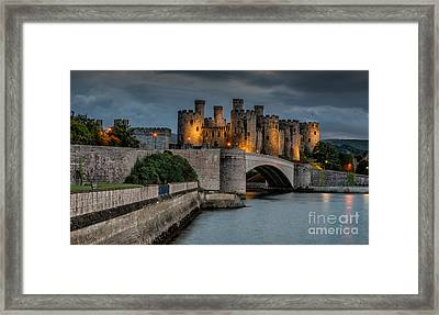 Conwy Castle By Lamplight Framed Print by Adrian Evans