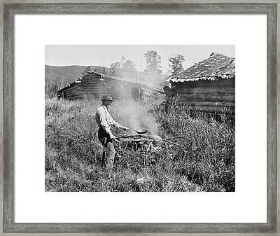 Cooking Over A Campfire Framed Print by Underwood Archives