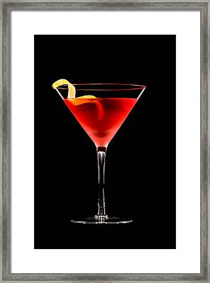Cosmopolitan Cocktail In Front Of A Black Background  Framed Print by Ulrich Schade
