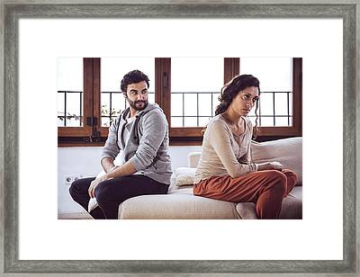 Couple Not Talking After A Fight On The Sofa In Living Room At H Framed Print by Eduardo Huelin
