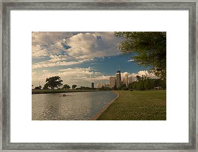 Couple Rowing In Chicago Framed Print by Sven Brogren