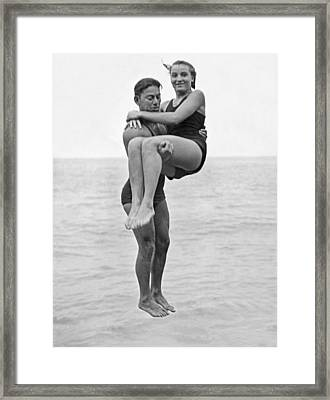 Couple Tandem Leaps Into Lake Framed Print by Underwood Archives