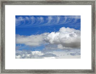 Courting Clouds Framed Print by Gwyn Newcombe