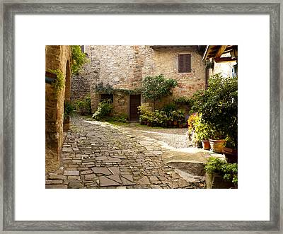 Courtyard In Montefioralle Framed Print by Rae Tucker