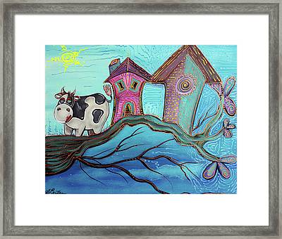 Cow In A Tree Framed Print by Laura Barbosa