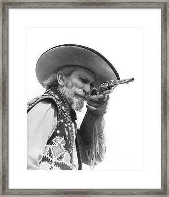 Cowboy Aiming A Gun, C.1930s Framed Print by H. Armstrong Roberts/ClassicStock