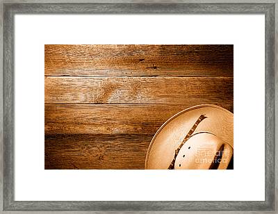 Cowboy Hat On Wood Table - Sepia Framed Print by Olivier Le Queinec