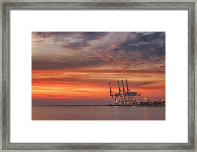 cranes and industrial cargo ships in Varna port at sunset Framed Print by Anek Suwannaphoom