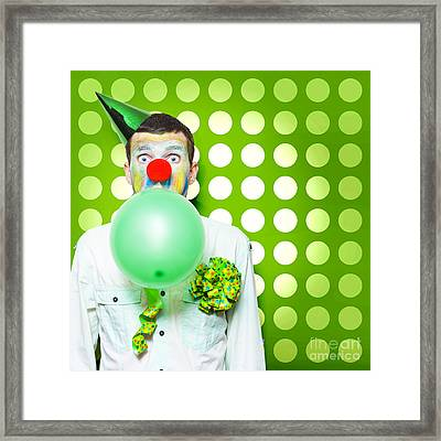 Crazy Party Clown Inflating Green Party Balloon Framed Print by Jorgo Photography - Wall Art Gallery