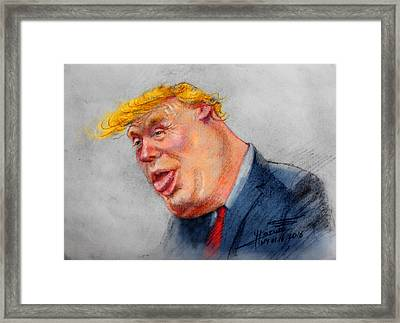 Crooked Trump Framed Print by Ylli Haruni