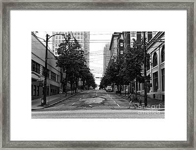 Crossing An Empty Street Mono Framed Print by John Rizzuto