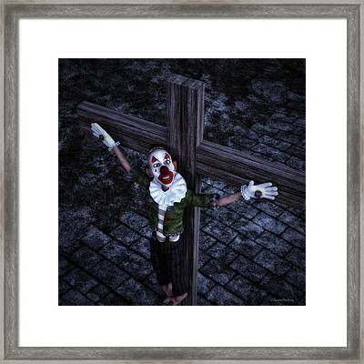 Crucified Clown Framed Print by Ramon Martinez