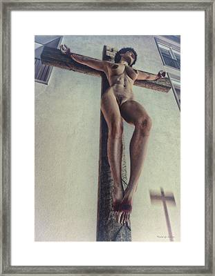 Crucified In The Street Framed Print by Ramon Martinez