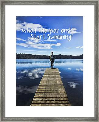 Crystal Blue Lake Pier And Person Swimming Framed Print by Elaine Plesser
