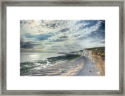 Curling Cliffs Framed Print by Ann Garrett