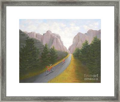 Cycling To The Pearly Gates Framed Print by Phyllis Andrews