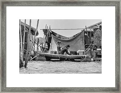 Daily Life On The Tonle Sap Framed Print by Georgia Fowler