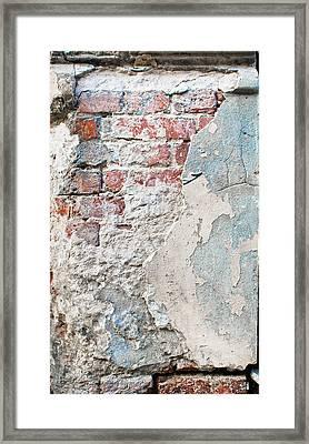 Damaged Brick Wall Framed Print by Tom Gowanlock