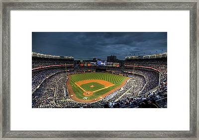 Dark Clouds Over Yankee Stadium  Framed Print by Shawn Everhart
