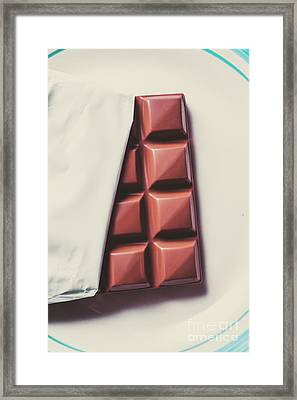 Delicious Chocolate Bar In Wrapping On Plate Framed Print by Jorgo Photography - Wall Art Gallery