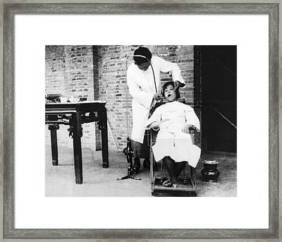 Dentistry In China Framed Print by Underwood Archives