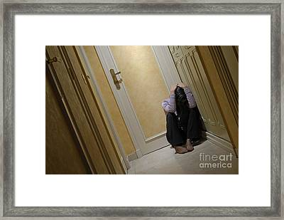 Depressed Woman Sitting In Corridor With Head In Hands Framed Print by Sami Sarkis