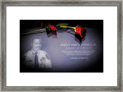 Deputy Kotfila Framed Print by Marvin Spates