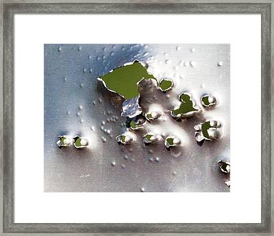 Dimpled And Ripped Framed Print by Bill Kesler