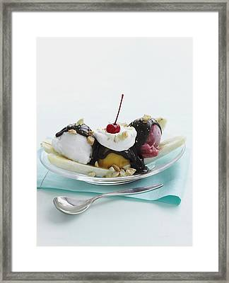 Dish Of Banana Split Sundae Framed Print by Cultura/BRETT STEVENS