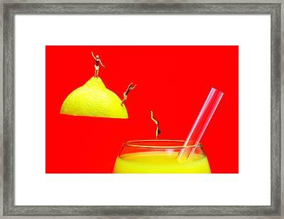 Diving Into Orange Juice Framed Print by Paul Ge