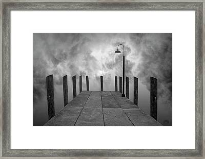 Dock And Clouds Framed Print by Dave Gordon